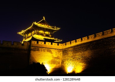 Pingyao, Shanxi province, China - The ancient walls protecting the Old city at night. Known as one of the best preserved villages of China, Pingyao is a UNESCO world Heritage site