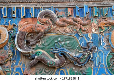 Pingyao in Shanxi Province, China. Detail of the Nine Dragon Wall or Nine Dragon Screen in Pingyao. Pingyao old town is a famous ancient walled city in China.
