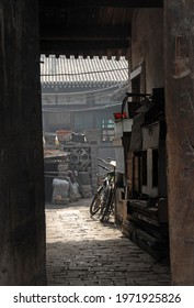 Pingyao in Shanxi Province, China. View through a doorway into an alley and courtyard with bicycles in Pingyao. Pingyao old town is a famous ancient walled city in China.