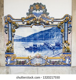 Pinhao, Portugal, 5/11/2018: Azulejos -  traditional Portuguese tiled panels -  depicting local scenes decorate the exterior of Pinhao train station.
