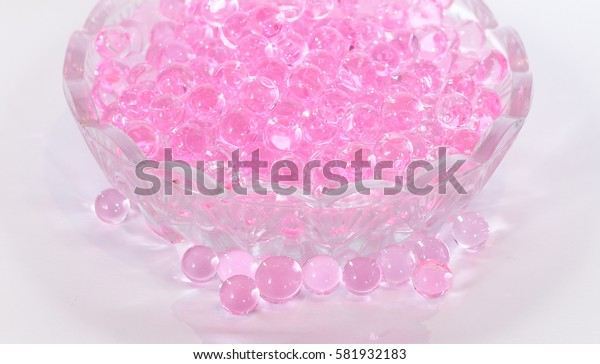 Pink aroma beads in a small glass dish for the jam