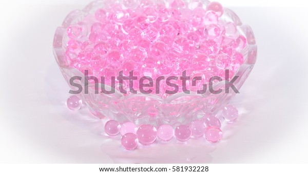 Pink aroma beads in a small glass dish
