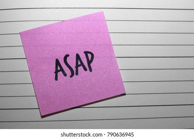 """Pink """"ASAP"""" Sticky Note on Lined Diary Page"""