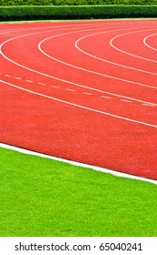 Pink Athletics Track Lanes and Green grass