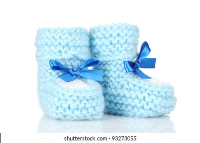 pink baby booties blue isolated on white