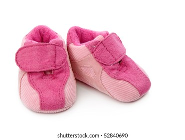 Pink baby shoes isolated on white background