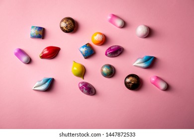 Pink background with chocolate bombons