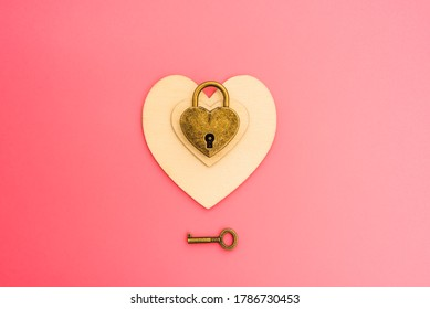 Pink background with romantic heart-shaped padlock, chained love concept.