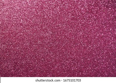 Pink background with sequins on it. Copy space. Trendy background. Festive backdrop for your projects.