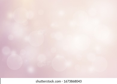 Pink background with shiny bokeh and bright light