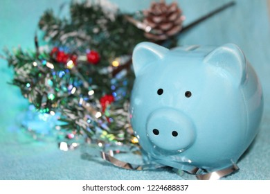 pink background with stars and blue pig new year 2019 Financial long term saving money concept, blue piggy bank, coins stacked and alarm clock on wood table, compound interest of investment awareness