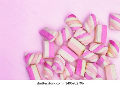 Pink Background from sweet small marshmallows. Greeting card wiht copy space for Birthday, anniversary, holiday. Top view.