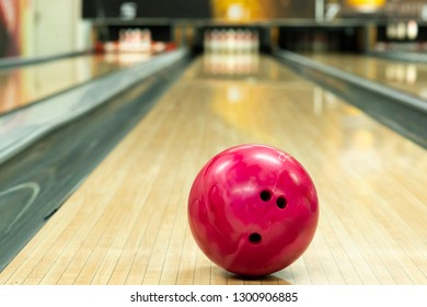 Pink ball on floor in bowling club - Image