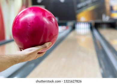 Pink ball on floor in bowling club