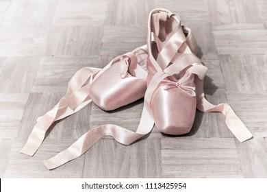 Pink Ballet shoes on parquet floor