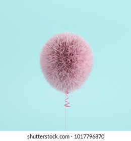 Pink Balloon Fur floating on blue background. minimal concept idea.