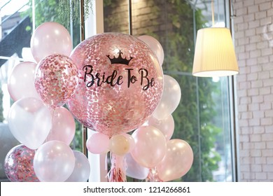 Pink balloons. Helium balloons in pink and white theme decoration for the hen party with the words written as Bride to be.