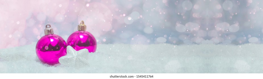 pink baubles on snow snowflakes - Christmas winter background banner long