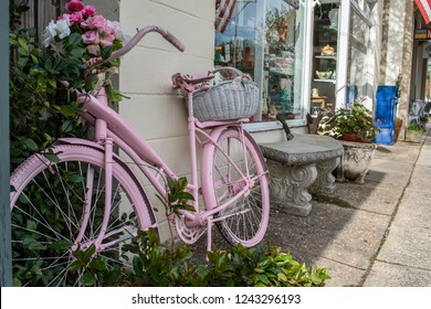 Pink Beach Bike Cruiser, leaning against a wall in the historic downtown town of Beaufort, NC. Flower, basket - carefree days