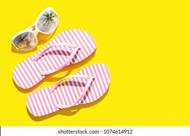 Pink Beach flip flop on yellow background