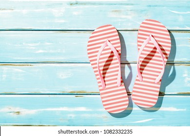 Pink Beach flip flop on wooden floor