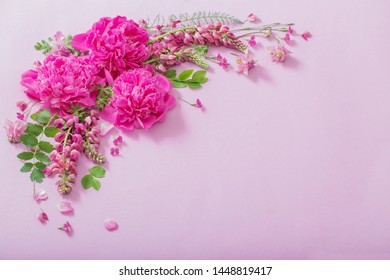 pink beautiful flowers on pink paper background