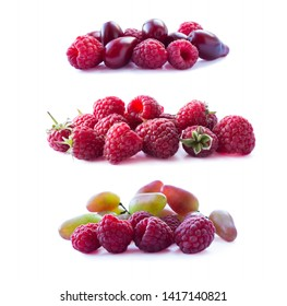 Pink berries isolated on white background. Ripe raspberries, red berries and grapes. Background of mix berries with copy space for text. Mix berries on white. Fruits isolated on white background.