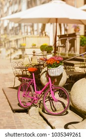 pink bike standing on an old street of an old town in Gdansk, Poland