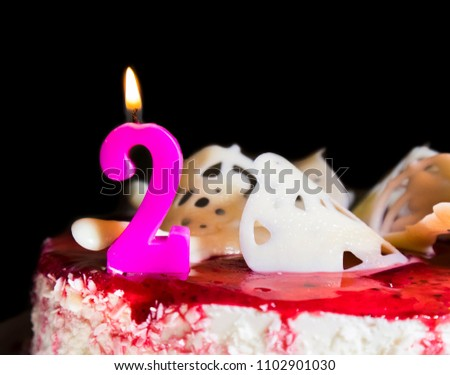 Pink Birthday Candle Number 2 Burning On Red Cake Showing Second Card Concept