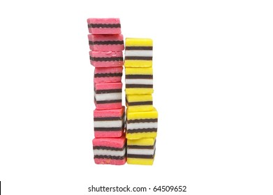 pink black yellow licorice isolated over white