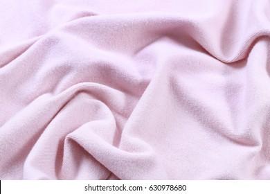 Pink blanket background.