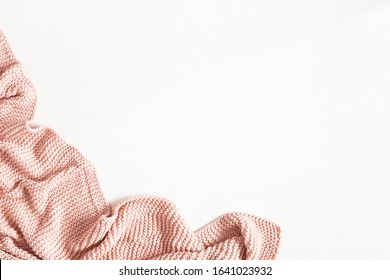 Pink blanket on white background. Flat lay, top view