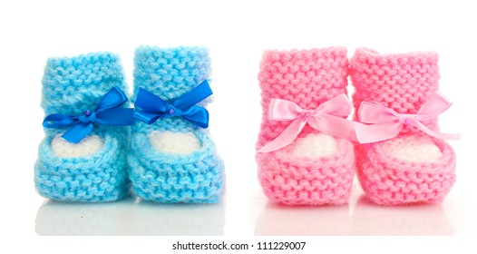 pink and blue baby boots isolated on white