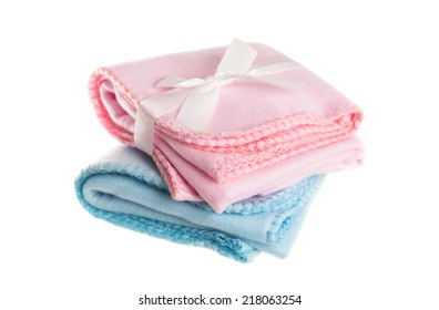 Pink and blue baby recieving blankets, isolated on a white background.