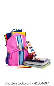 Pink and blue backpack with school supplies including notebooks, folders, ruler, pens, pencils, apple, paint and textbook on white with copy space