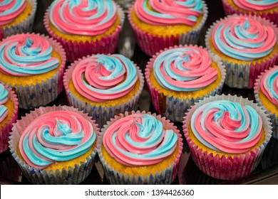 Pink and blue colorful gender reveal cupcakes