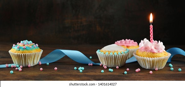 pink and blue decorated muffins or cupcakes with a ribbon