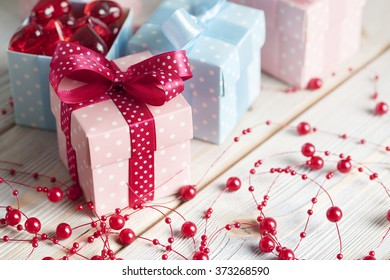 Pink and blue gift boxes on wooden background