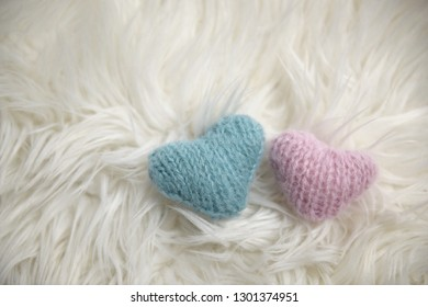 Pink and blue hand knit hearts
