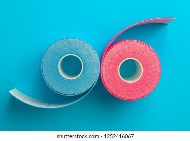 Pink and blue kinesiotape on blue background