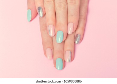 Pink and blue manicure design with silver line . Beautiful nails