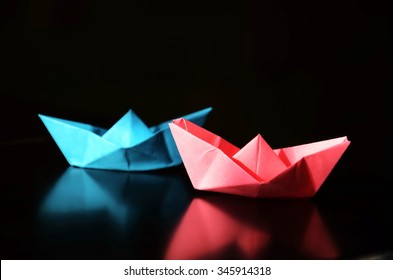 Pink and blue origami ships