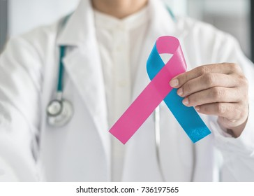 Pink blue ribbon awareness, symbolic bow color for birth defect, Sudden Infant Death Syndrome (SIDS), infertility pregnancy loss, and International Prenatal Infection Prevention Month in doctor's hand