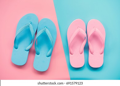 pink and blue sandals on pink and blue pastel background. Lover and Summer concept with copy space.