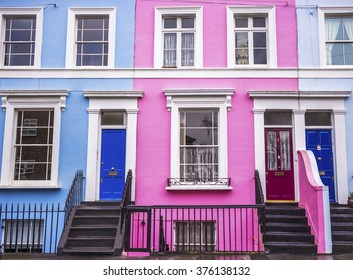 Pink and blue traditional colorful houses and stairs at Notting Hill district, near Portobello road in London, UK