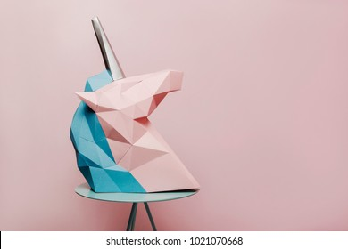 pink and blue unicorn with silver horn on pink background
