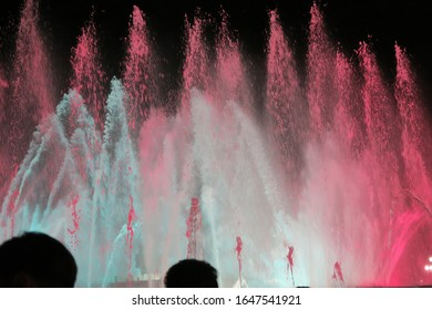 pink and blue water fountain show called The Magic Fountain of Montjuïc in Barcelona, Spain