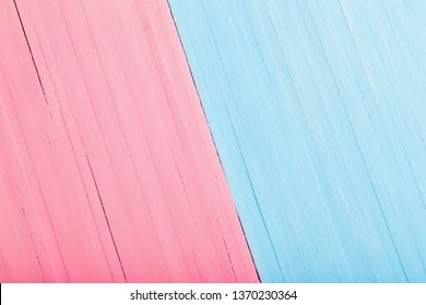 Pink and blue wooden background. Man and woman concept