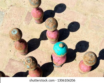 Pink and blue wooden skittles on brick background