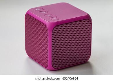 Pink bluetooth speaker cube close-up